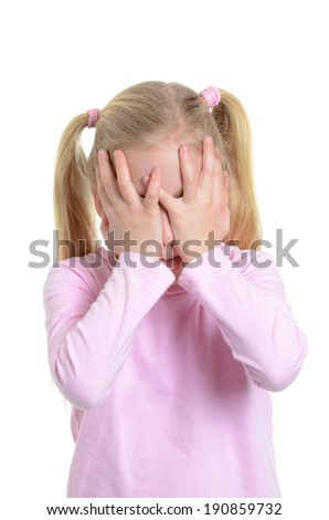 little girl hiding her eyes with hands  - stock photo