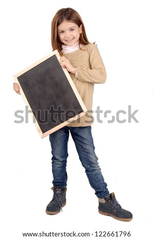 little girl holding a black board - stock photo