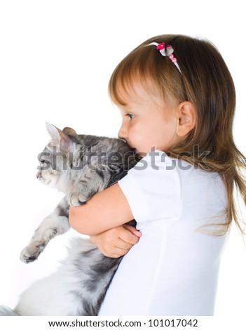 Little girl holding a cat looks left on white background - stock photo
