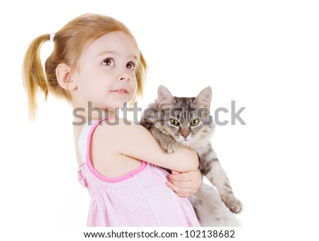 Little girl holding a cat looks up on white background - stock photo