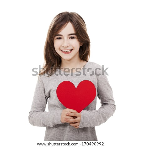 Little girl holding a heart made with paper , isolated over a white background