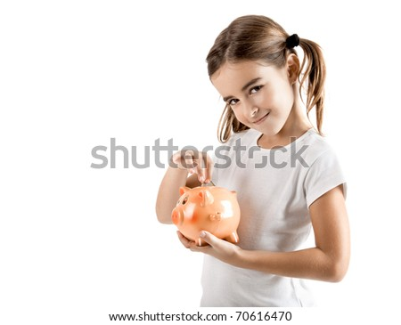 Little girl holding a piggy-bank and inserting a one euro coin - stock photo