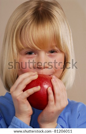 Little girl holding a red apple,little kid eating an apple. - stock photo
