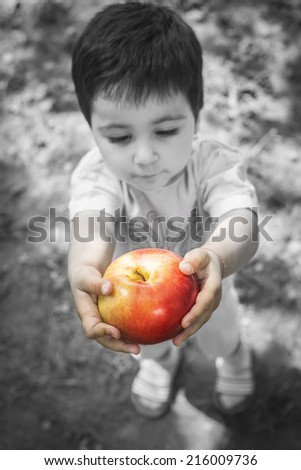 Little girl holding an apple. - stock photo