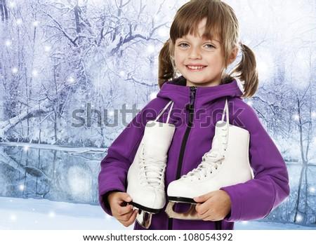 little girl holding an ice skates - stock photo