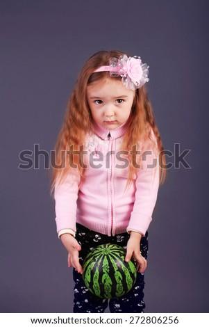 Little girl holding ball  - stock photo