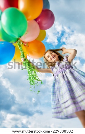 little girl holding color balloons - stock photo