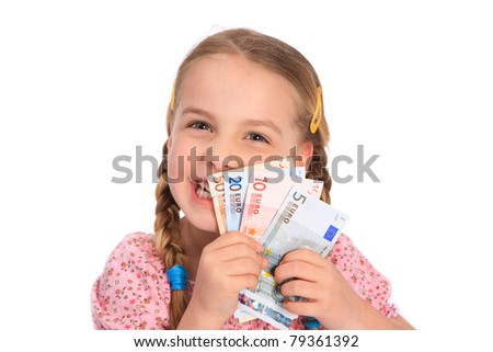 little girl holding euro banknotes in her hands and laughing - stock photo