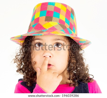 Little girl holding finger on the lips - stock photo