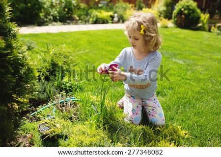 Little girl holding flower, summer outdoor - stock photo