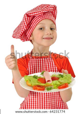 little girl holding plate with ham - stock photo