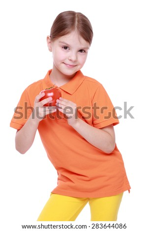 little girl holding red tomato isolated over white - stock photo