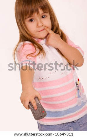 Little girl holding remote control pad - stock photo