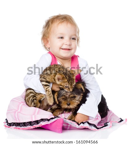little girl hugging a kitten and a puppy. isolated on white background