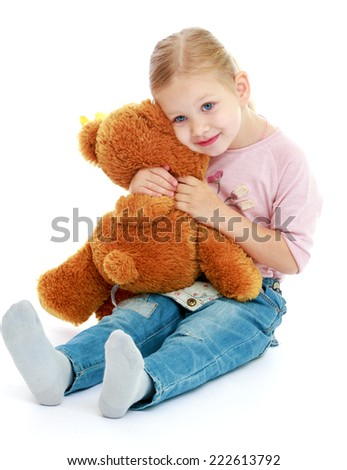 Little girl hugging a teddy bear.Childhood education development in the Montessori school concept. Isolated on white background. - stock photo