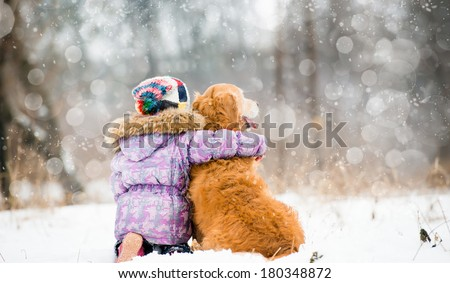 little girl hugging dog and looks forward - stock photo
