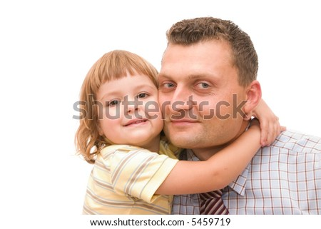 little girl hugging her father after he came back from work - stock photo