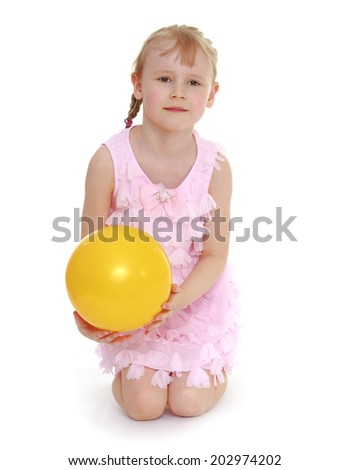 little girl hugging the ball.isolated on white background, sports life,happiness concept,happy childhood,carefree childhood,active lifestyle - stock photo