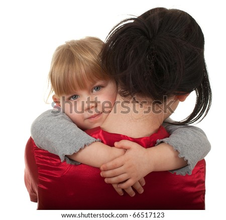 little girl hugging to mother, in her arms