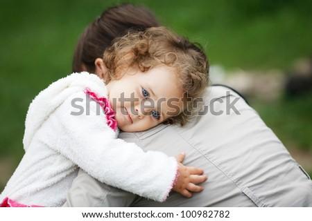little girl hugs her mother - stock photo
