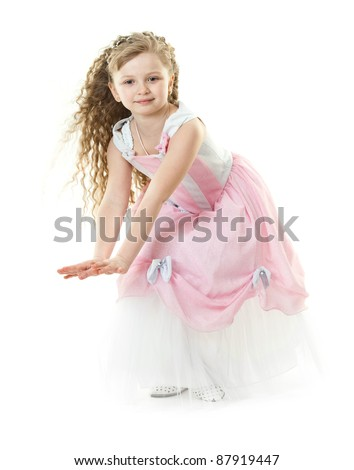 Little girl in a beautiful rose dress isolated