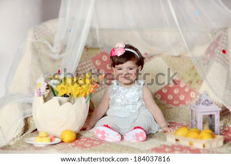 little girl in a beautiful white dress with flowers and lemons