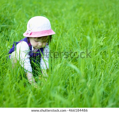 little girl in a blue dress on nature