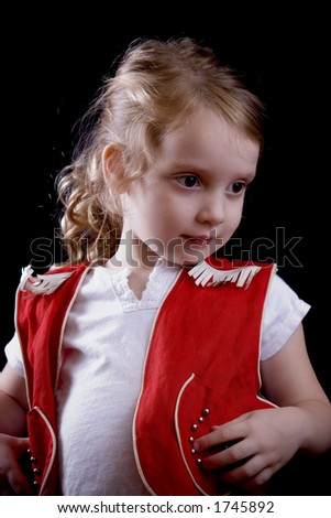 Little girl in a bright red cowgirl outfit.