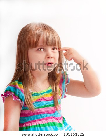 little girl in a dress the color posing in studio - stock photo
