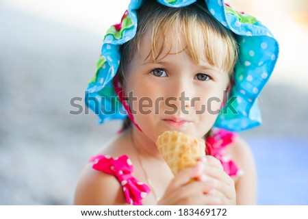 little girl in a hat with ice cream - stock photo