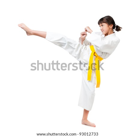 little girl in a kimono with a yellow sash on a white background - stock photo