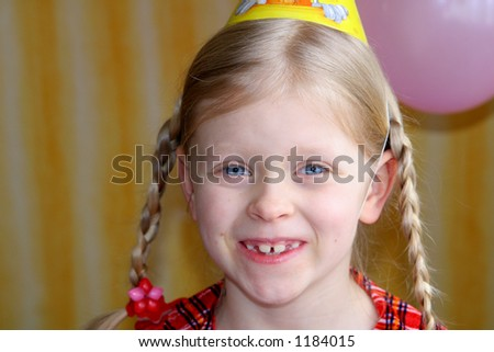Little girl in a party hat - stock photo