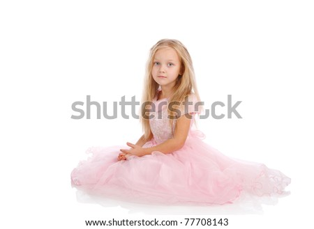 little girl in a pink elegant dress.White background