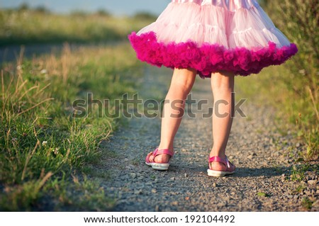 Little girl in a pink skirt
