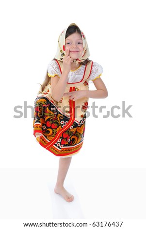 Little girl in a shawl dances. Isolated on white background