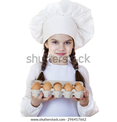 Little girl in a white apron breaks near the plate with eggs, isolated on white background - stock photo