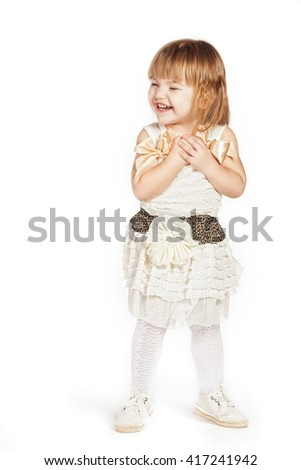 Little girl in a white dress - stock photo