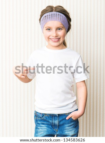 little girl in a white t-shirt - stock photo