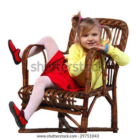 Little girl in a wicker chair on a white background