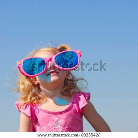 little girl in big glasses - stock photo