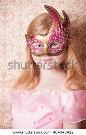 little girl in carnival mask - stock photo