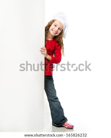 little girl in chef hat with a white board - stock photo