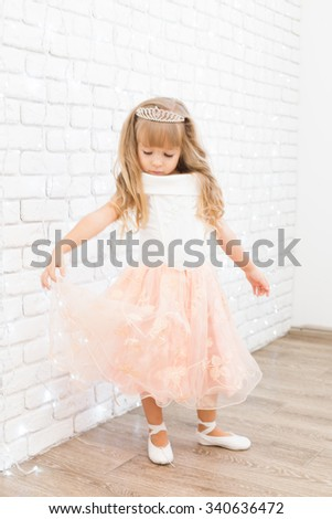 Little girl in christmas decorations