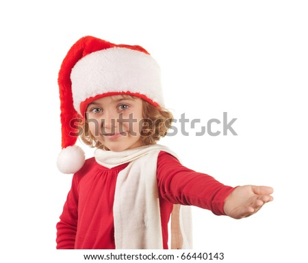 Little girl in Christmas hat pointing, isolated on white
