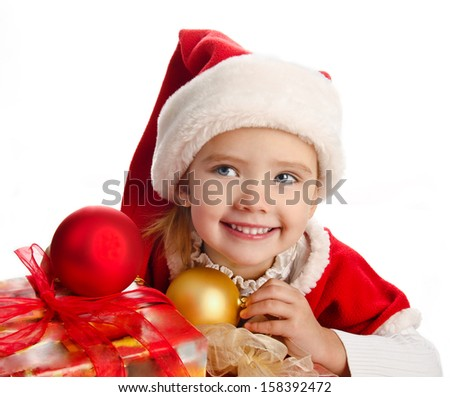 Little girl in christmas hat with gift box and balls isolated