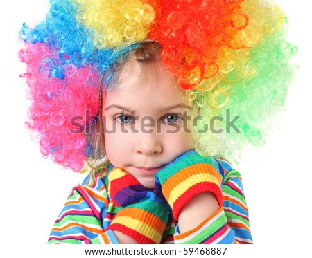 little girl in clown wig and multicolored gloves looking at camera, chin on hands, half body, isolated - stock photo