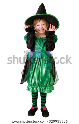 Little girl in costume for Halloween shows a wicked witch
