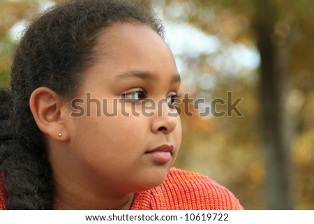 Little girl in deep thought - stock photo