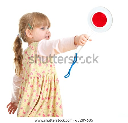 little girl in dress keeping stopping sign - stock photo