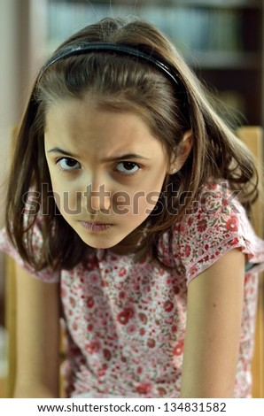 Little Girl in Fear. Portrait of Hispanic child with scared face. - stock photo